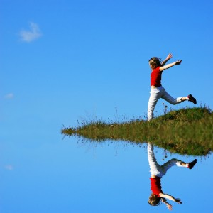 Woman Jumping - Grass.Sky